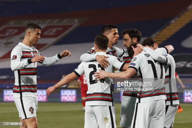 Portugal's forward Diogo Jota is congratulated by teammates after scoring a goal during the FIFA World Cup Qatar 2022 qualification Group A football...