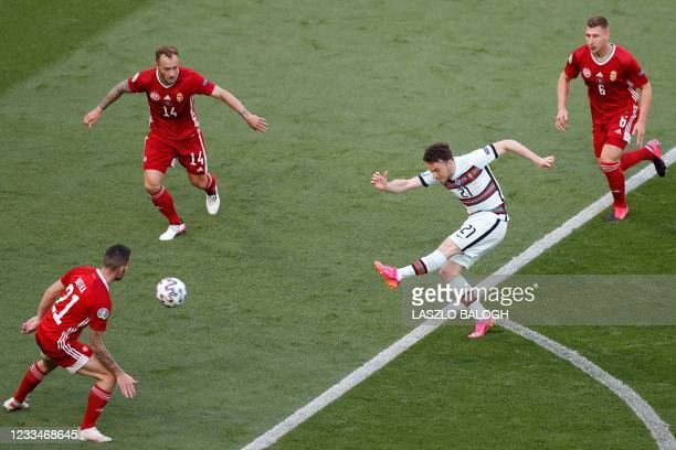 Portugal's forward Diogo Jota kicks the ball past Hungary's defender Endre Botka , Hungary's defender Gergo Lovrencsics and Hungary's defender Willi...