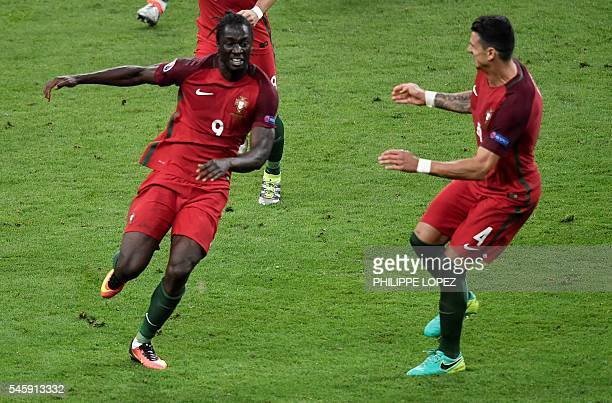 Portugal's forward Eder celebrates after scoring a goal with Portugal's defender Fonte during the Euro 2016 final football match between Portugal and...