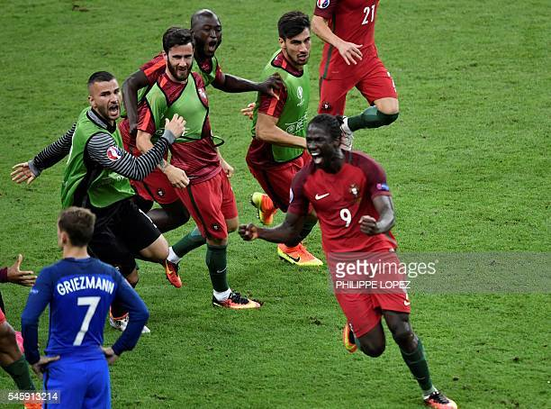 Portugal's forward Eder celebrates after scoring a goal with team mates next to France's forward Antoine Griezmann during the Euro 2016 final...