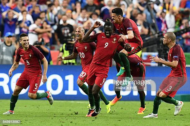 Portugal's forward Eder celebrates with Portugal's defender Pepe and Portugal's defender Raphael Guerreiro the team's first goal during the Euro 2016...