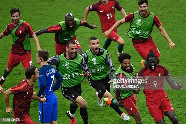 Portugal's forward Eder celebrates with team mates after scoring a goal during the Euro 2016 final football match between Portugal and France at the...