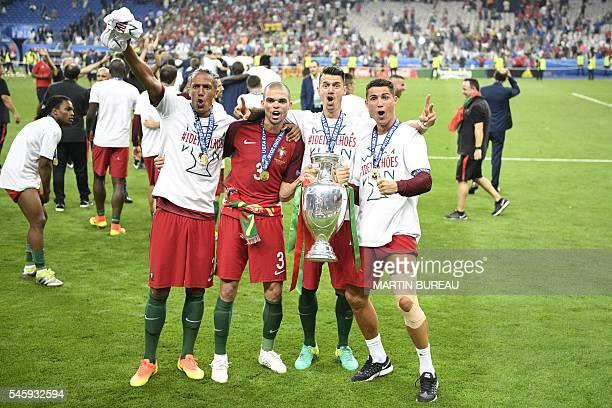 TOPSHOT Portugal's forward Eder Portugal's defender Pepe Portugal's defender Fonte pose with Portugal's forward Cristiano Ronaldo as he holds the...