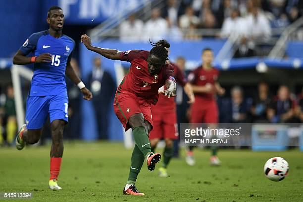 Portugal's forward Eder shoots to score the team's first goal during the Euro 2016 final football match between France and Portugal at the Stade de...