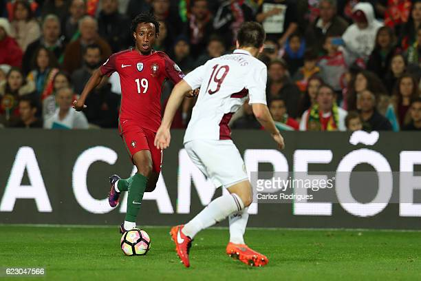 Portugal's forward Gelson Martins from Portugal tries to pass trough Latvia's defender Vitalis Jagodinskis from Latvia during the Portugal v Latvia...