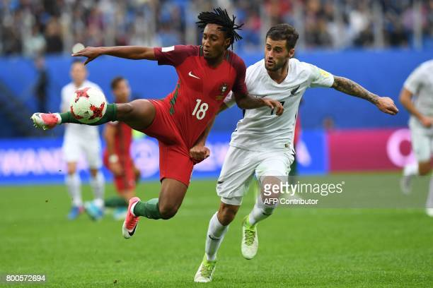 Portugal's forward Gelson Martins vies with New Zealand's defender Thomas Doyle during the 2017 Confederations Cup group A football match between New...