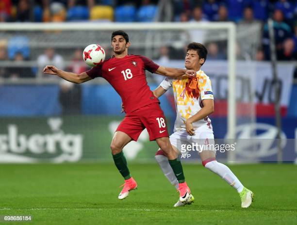 Portugal's forward Goncalo Guedes and Spain's defender Jorge Mere vie for the ball during the UEFA U21 European Championship Group B football match...