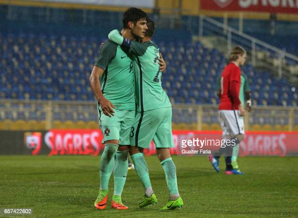 Portugal's forward Goncalo Paciencia celebrates with teammate Portugal's forward Ricardo Horta after scoring a goal during the U21 International...