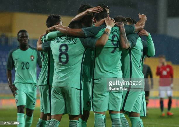 Portugal's forward Goncalo Paciencia celebrates with teammates after scoring a goal during the U21 International Friendly match between Portugal and...