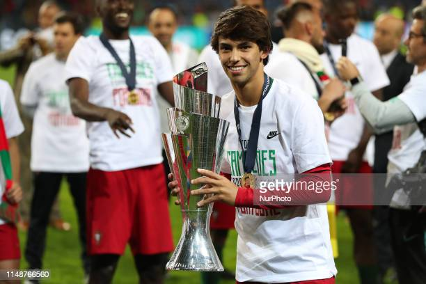 Portugal's forward Joao Felix poses with the trophy after winning the UEFA Nations League Final football match between Portugal and Netherlands at...