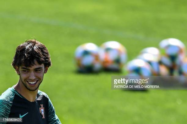 Portugal's forward Joao Felix smiles during a training session at Cidade do Futebol training camp in Oeiras outskirts of Lisbon on September 3 ahead...
