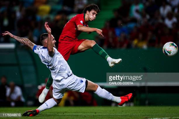 Portugal's forward Joao Felix vies with Luxembourg's defender Maxime Chanot during the Euro 2020 qualifier group B football match between Portugal...