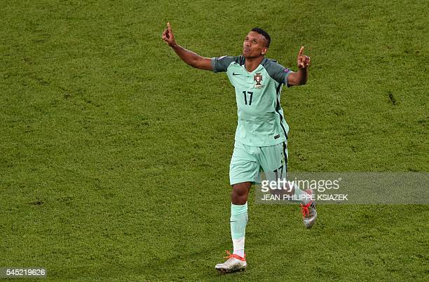 TOPSHOT Portugal's forward Nani celebrates after scoring a goal during the Euro 2016 semifinal football match between Portugal and Wales at the Parc...