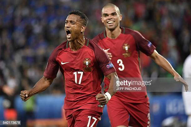Portugal's forward Nani celebrates the team's first goal along with Portugal's defender Pepe during the Euro 2016 group F football match between...
