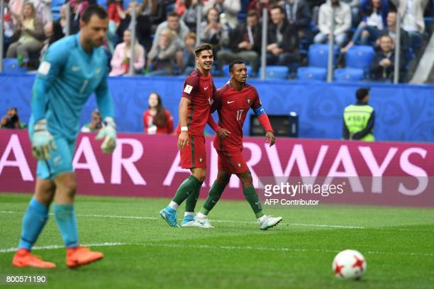Portugal's forward Nani celebrates with Portugal's forward Andre Silva after scoring a goal during the 2017 Confederations Cup group A football match...