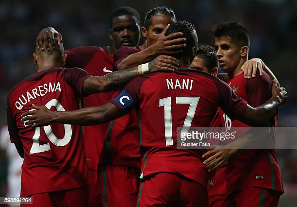 Portugal's forward Nani celebrates with teammates after scoring a goal during the International Friendly match between Portugal and Gibraltar at...