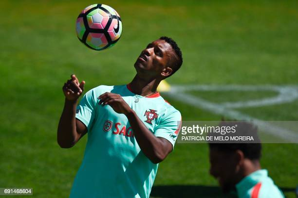 Portugal's forward Nani Cunha heads the ball during a training session at 'Cidade do Futebol' training camp in Oeiras outskirts of Lisbon on June 2...