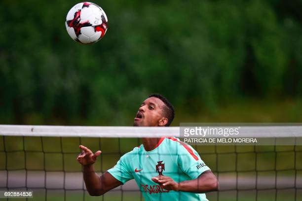 Portugal's forward Nani eyes the ball during a training session at 'Cidade do Futebol' training camp in Oeiras outskirts of Lisbon on June 6 2017 two...
