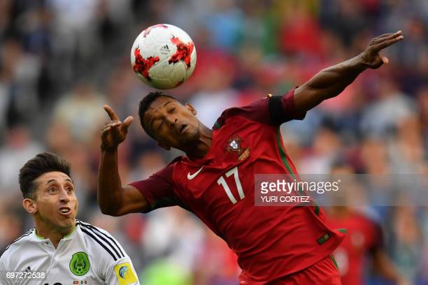 TOPSHOT Portugal's forward Nani heads the ball as Mexico's midfielder Hector Herrera look on during the 2017 Confederations Cup group A football...