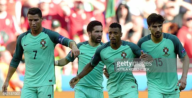 Portugal's forward Nani is congratulated by Portugal's forward Cristiano Ronaldo after scoring a goal during the Euro 2016 group F football match...