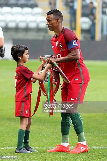 PortugalÕs forward Nani receives the European Cup from Tiago a Portuguese fan during the match between Portugal vs Gilbratar friendly match at...
