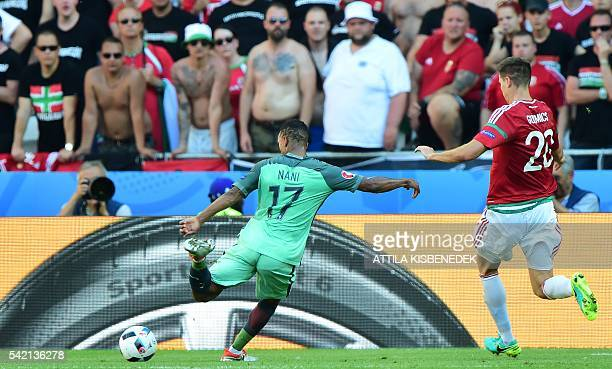TOPSHOT Portugal's forward Nani scores a goal during the Euro 2016 group F football match between Hungary and Portugal at the Parc Olympique Lyonnais...