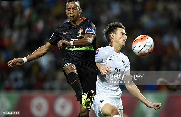 Portugal's forward Nani vies with France's defender Laurent Koscielny during the Euro 2016 friendly football match Portugal vs France at the Jose...