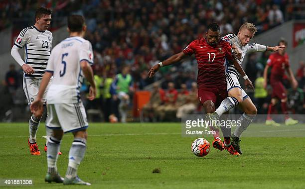 Portugal's forward Nani with Denmark's Daniel Wass in action during the UEFA EURO 2016 Qualifier match between Portugal and Denmark at Estadio...