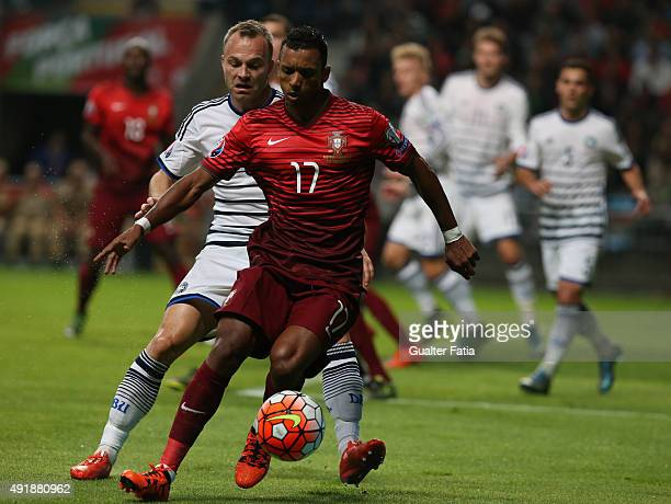 Portugal's forward Nani with Denmark's Lars Jacobsen in action during the UEFA EURO 2016 Qualifier match between Portugal and Denmark at Estadio...