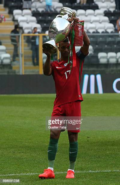 Portugal's forward Nani with the Euro 2016 trophy before the start of the International Friendly match between Portugal and Gibraltar at Estadio do...
