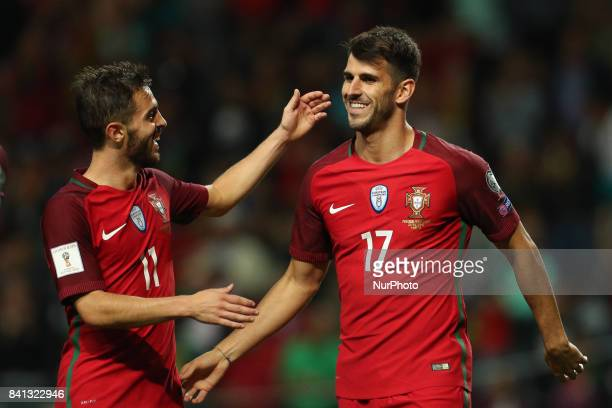 Portugal's forward Nelson Oliveira celebrates after scoring a goal with Portugal's midfielder Bernardo Silva during the FIFA World Cup Russia 2018...