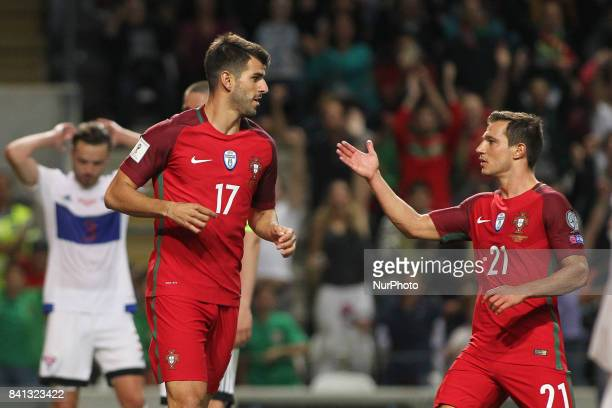 Portugal's forward Nelson Oliveira celebrates after scoring goal with Portugal's defender Cedric during the FIFA World Cup Russia 2018 qualifier...