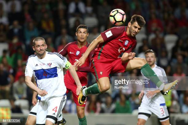 Portugal's forward Nelson Oliveira heads the ball during the 2018 FIFA World Cup qualifying football match between Portugal and Faroe Islands at the...
