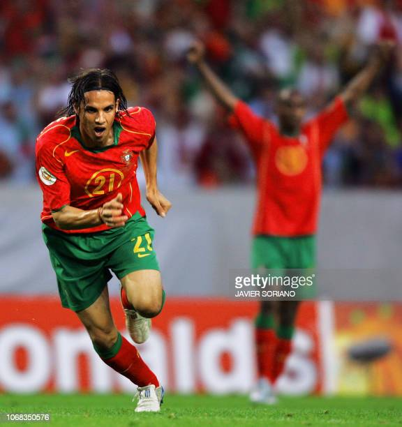 Portugal's forward Nuno Gomes celebrates his opening goal, 20 June 2004 at Jose Alvalade stadium in Lisbon, during his team's Euro 2004 group A...