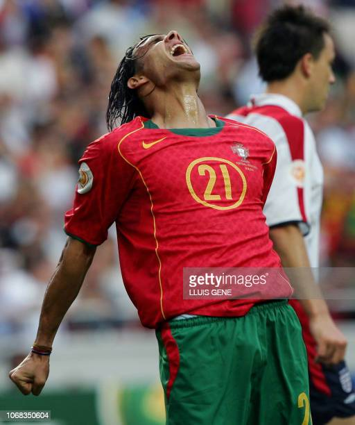 Portugal's forward Nuno Gomes reacts after loosing a goal 24 June 2004 during their European Nations Championship quarterfinal football match between...