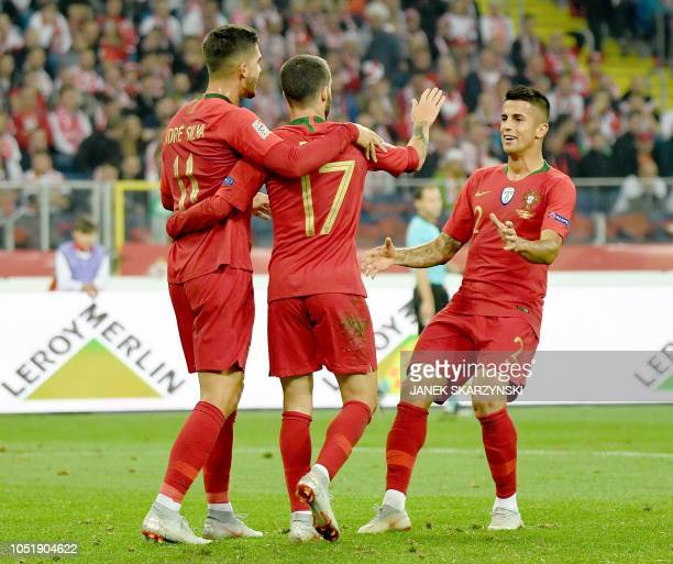 Portugal's forward Rafa Silva celebrates scoring with his teammates Andre Silva and defender Joao Cancelo during the UEFA Nations League football...