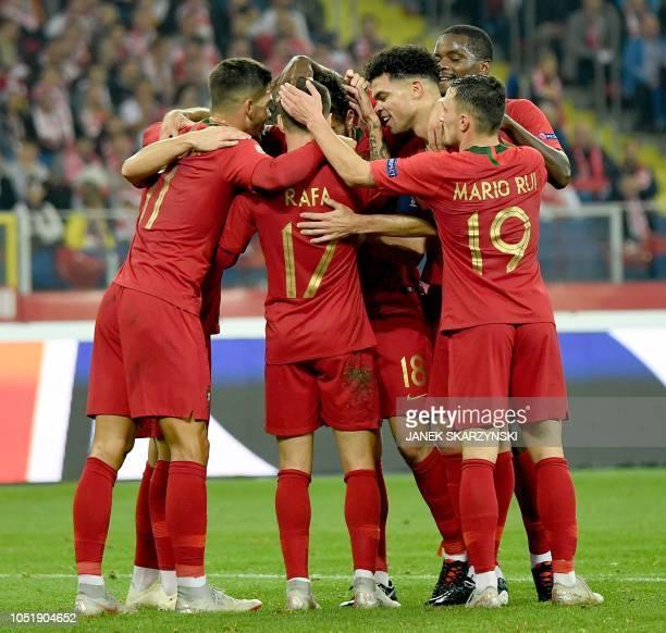 Portugal's forward Rafa Silva celebrates scoring with his teammates during the UEFA Nations League football match Poland v Portugal at the Slaski...