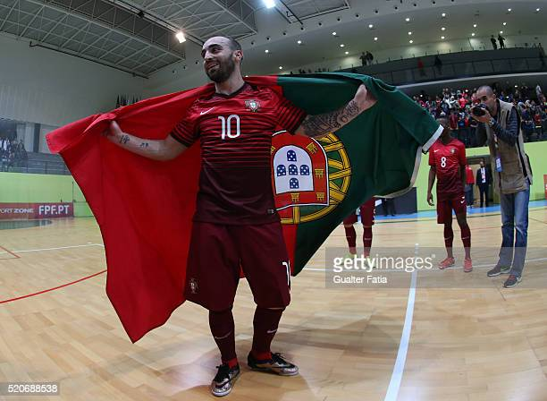 Portugal's forward Ricardinho celebrate the victory at the end of the FIFA Futsal playoff match between Portugal and Serbia at Pavilhao Multiusos de...