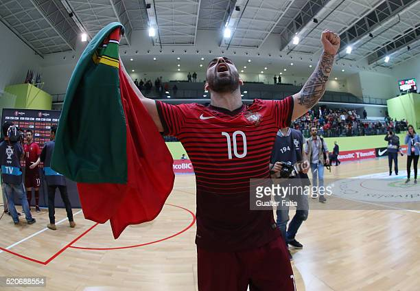 Portugal's forward Ricardinho celebrates the victory at the end of the FIFA Futsal playoff match between Portugal and Serbia at Pavilhao Multiusos de...