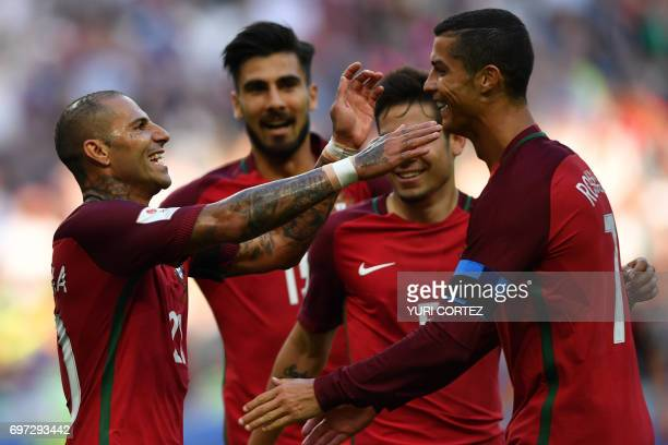 TOPSHOT Portugal's forward Ricardo Quaresma and Portugal's forward Cristiano Ronaldo celebrates after scoring a goal during the 2017 Confederations...