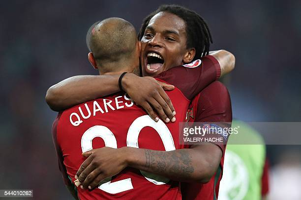 Portugal's forward Ricardo Quaresma and Portugal's midfielder Renato Sanches celebrate after winning the Euro 2016 quarterfinal football match...
