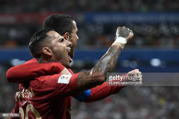TOPSHOT Portugal's forward Ricardo Quaresma celebrates scoring the opening goal with Portugal's forward Cristiano Ronaldo during the Russia 2018...