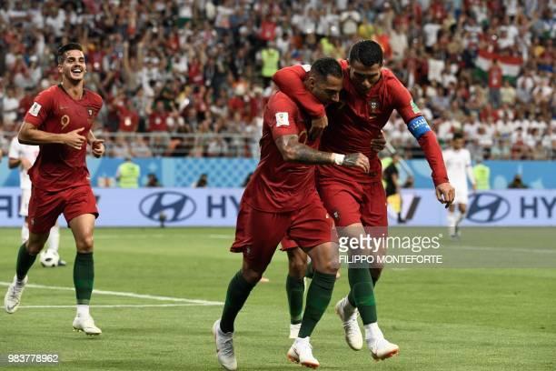 TOPSHOT Portugal's forward Ricardo Quaresma celebrates scoring the opening goal with Portugal's forward Cristiano Ronaldo during the Russia 2018...