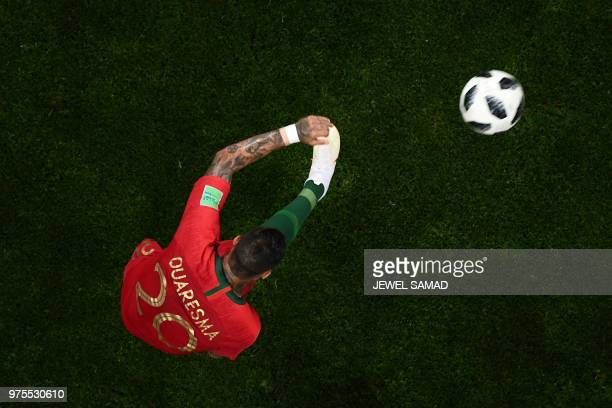 TOPSHOT Portugal's forward Ricardo Quaresma kicks the ball during the Russia 2018 World Cup Group B football match between Portugal and Spain at the...