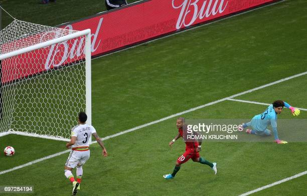 TOPSHOT Portugal's forward Ricardo Quaresma scores the first goal in the nets of Mexico's goalkeeper Guillermo Ochoa during the 2017 Confederations...