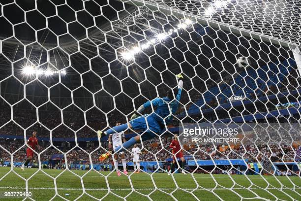 TOPSHOT Portugal's forward Ricardo Quaresma scores the opening goal past Iran's goalkeeper Alireza Beiranvand during the Russia 2018 World Cup Group...