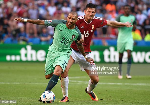 Portugal's forward Ricardo Quaresma vies for the ball with Hungary's midfielder Adam Pinter during the Euro 2016 group F football match between...