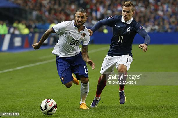 Portugal's forward Ricardo Quaresma vies with France's forward Antoine Griezmann during the friendly football match France vs Portugal on October 11...