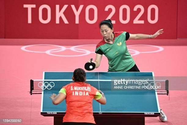 Portugal's Fu Yu competes against India's Sutirtha Mukherjee during their women's singles round 2 table tennis match at the Tokyo Metropolitan...