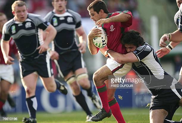 Portugal's fullback Pedro Leal is tackled by Scotland's centre Marcus Di Rollo during the rugby union World Cup match Scotland vs Portugal, 09...